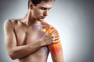 man with Shoulder Pain holds arm
