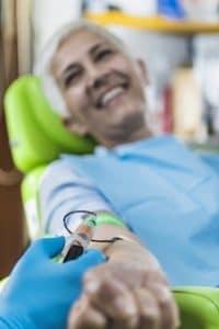 female patient receiving stem cell treatments